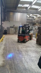 A forklift at the corrugated plant